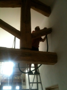Chris hoovering the beam before we oil it