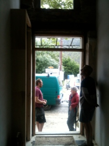 Working in the front of the house tends to arouse curiosity in the villagers!