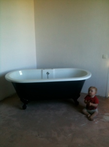 Our bath, poised and ready but not quite plumbed!